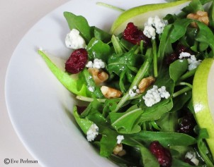 Pear salad with arugula, walnuts, blue cheese, and dried cranberries.
