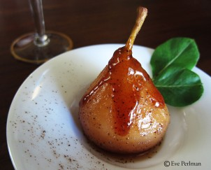 Poached pear in brandy spice reduction
